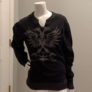 Guess sweater with a grey design on the front